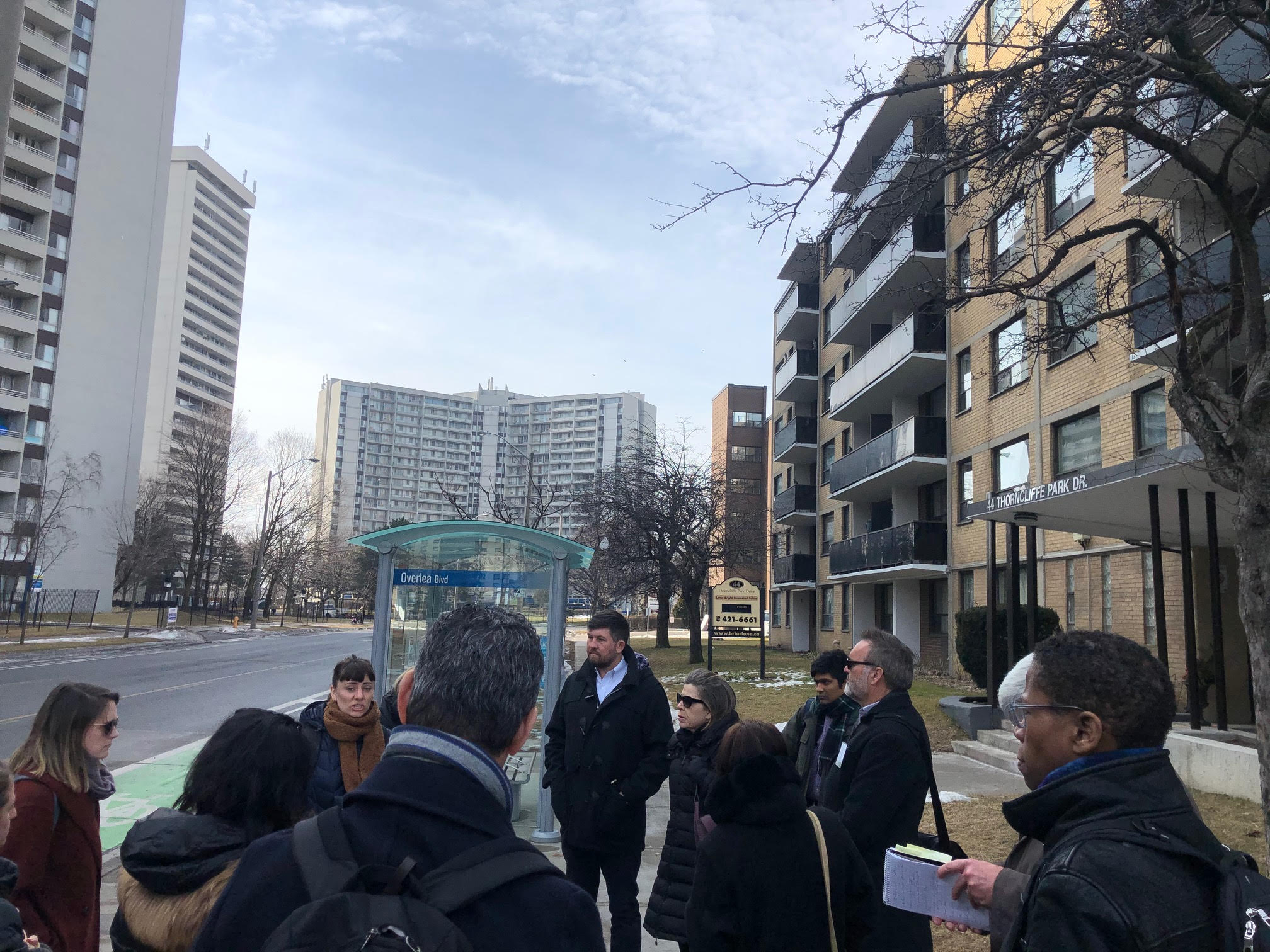 A group touring a tower neighbourhood in Toronto