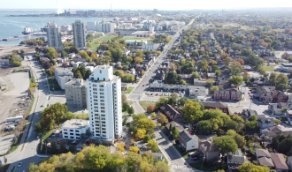 A drone photograph of the Ken Soble Tower with Hamilton harbour in the background