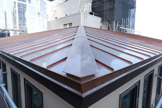 New copper penthouse roof.